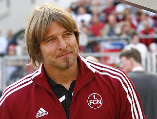 NUREMBERG, GERMANY - SEPTEMBER 12:  Head coach Michael Oenning of Nuernberg smiles before the Bundesliga match between 1.FC Nuernberg and Borussia Monchengladbach on September 12, 2009 at the Easy Credit Stadium in Nuremberg. (Photo by Alexandra Beier/Bongarts/Getty Images)